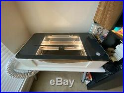 Glowforge Basic Laser Cutter & tons of Proofgrade Material (Very lightly used!)